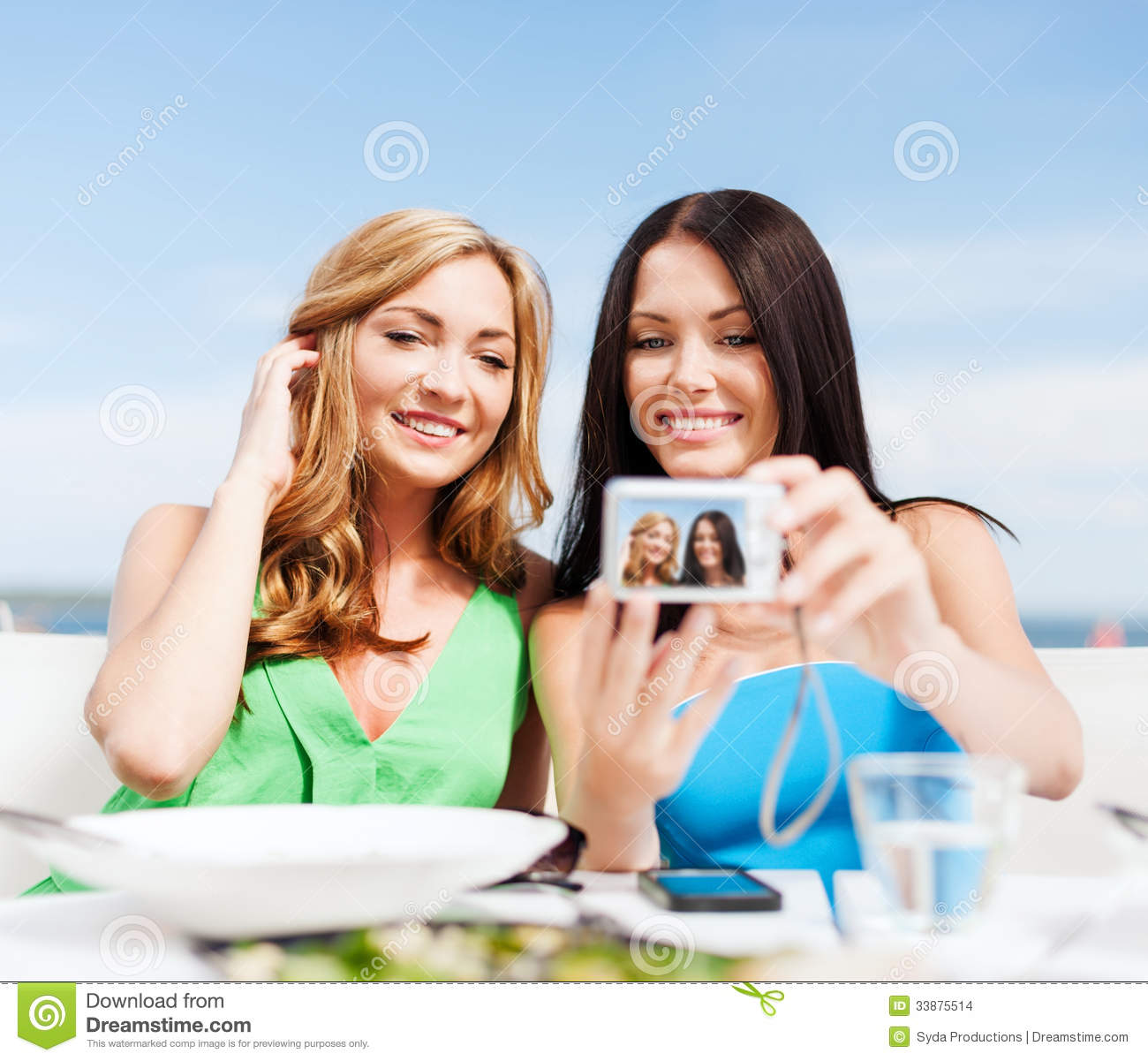 Girls Taking Photo In Cafe On The Beach Stock Photo Image