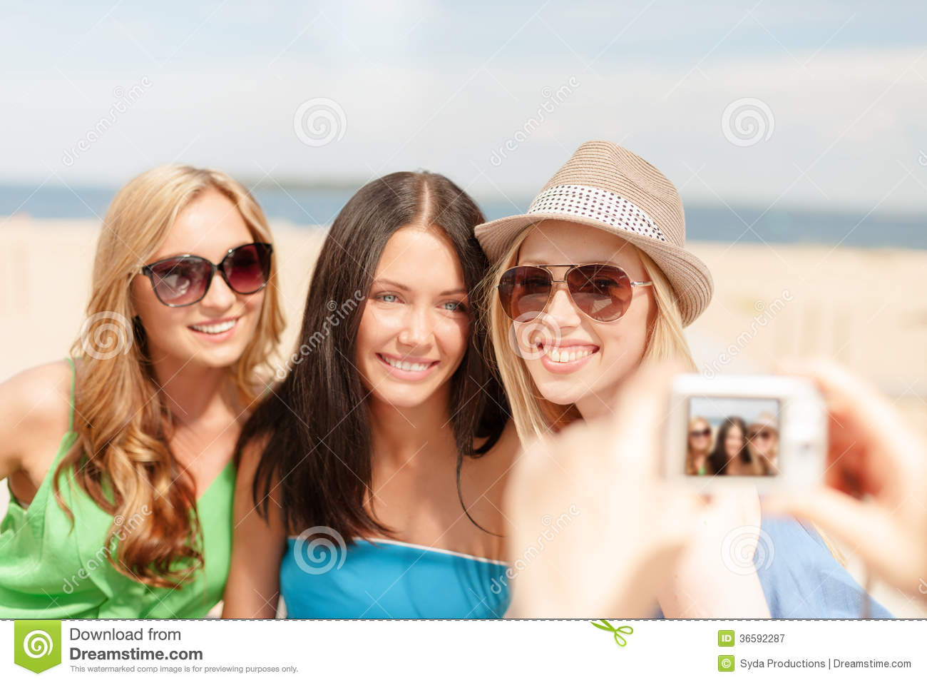 Girls Taking Photo With Digital Camera In Cafe Stock Image