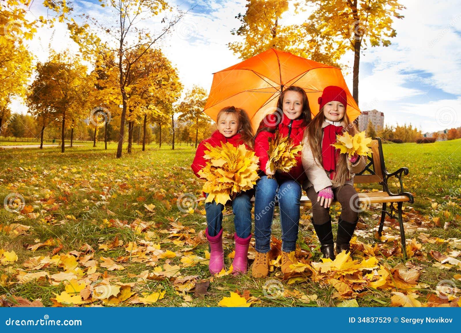 Girls Under Umbrella In Autum Park Royalty Free Stock