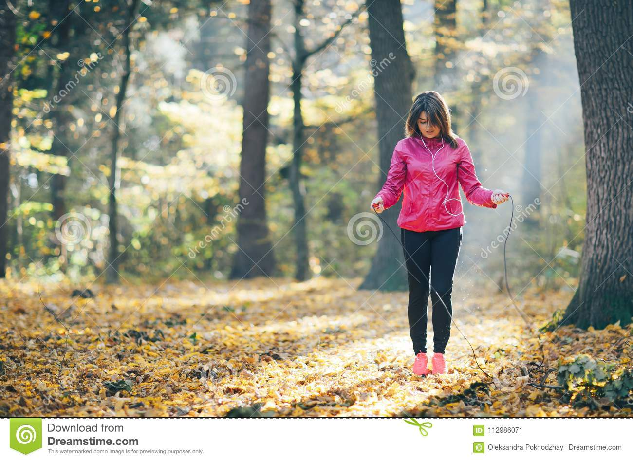 Girls who train and listen to music in the morning forest