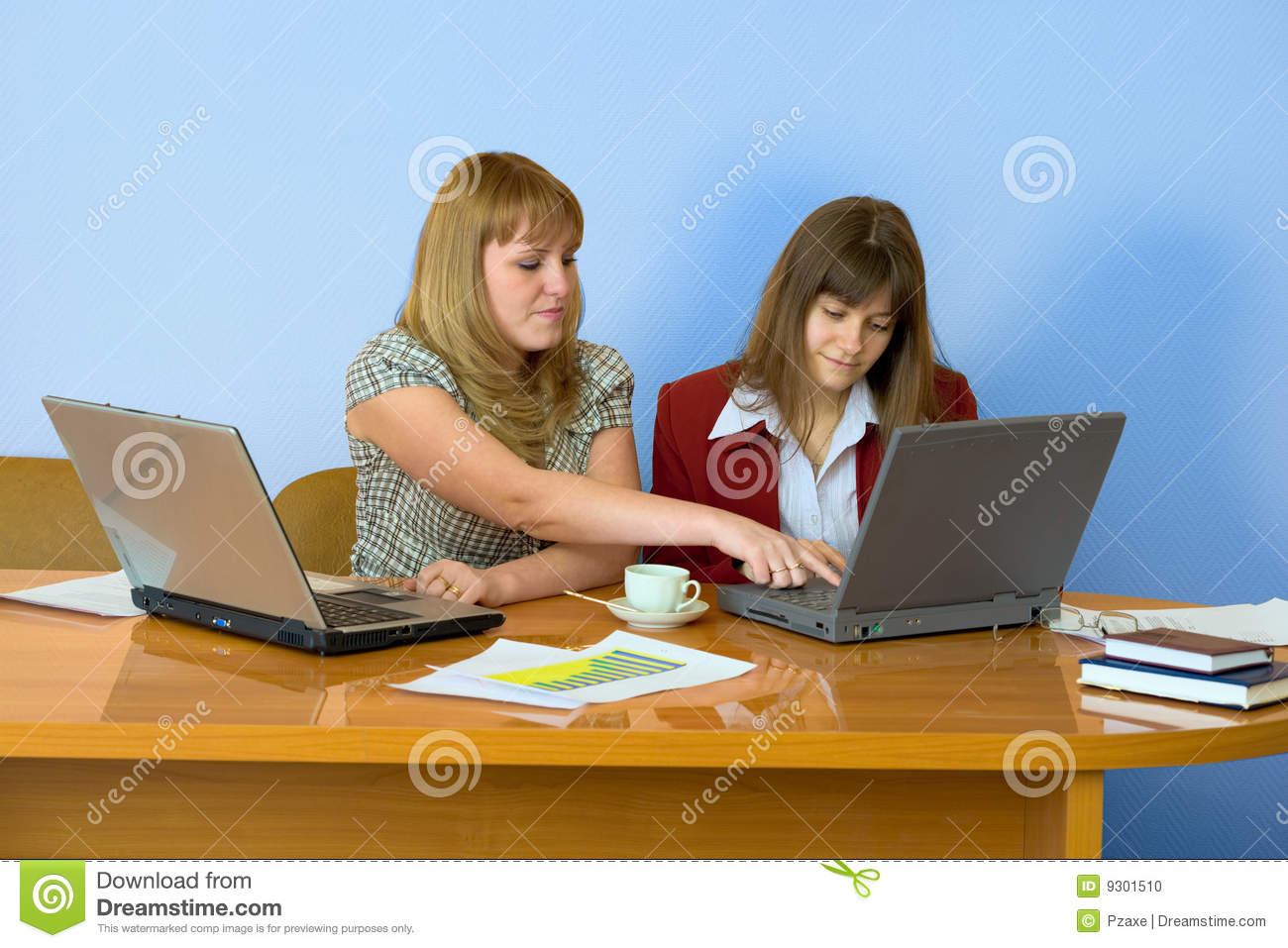 Girls work sitting at a table