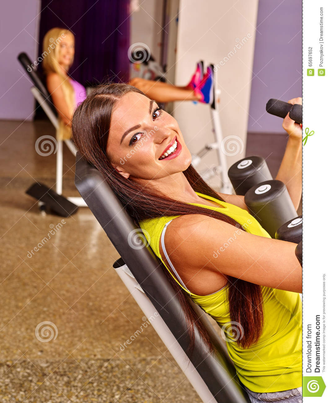 Amino Z Team Womens Weight Lifting Bodybuilding Gym: Girls Workout On Leg Press In Sport Gym. Stock Photo