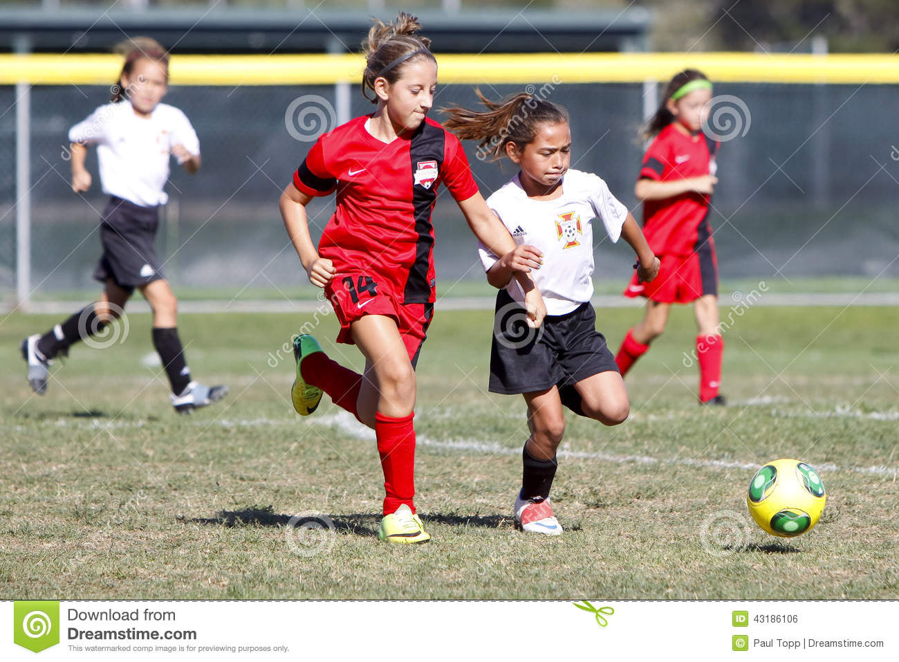 Girls Youth Soccer Football Players Running for the Ball