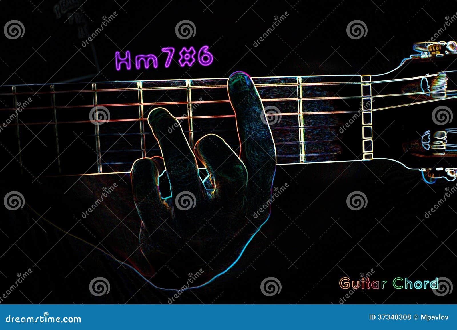 Gitarrackord på en mörk bakgrund