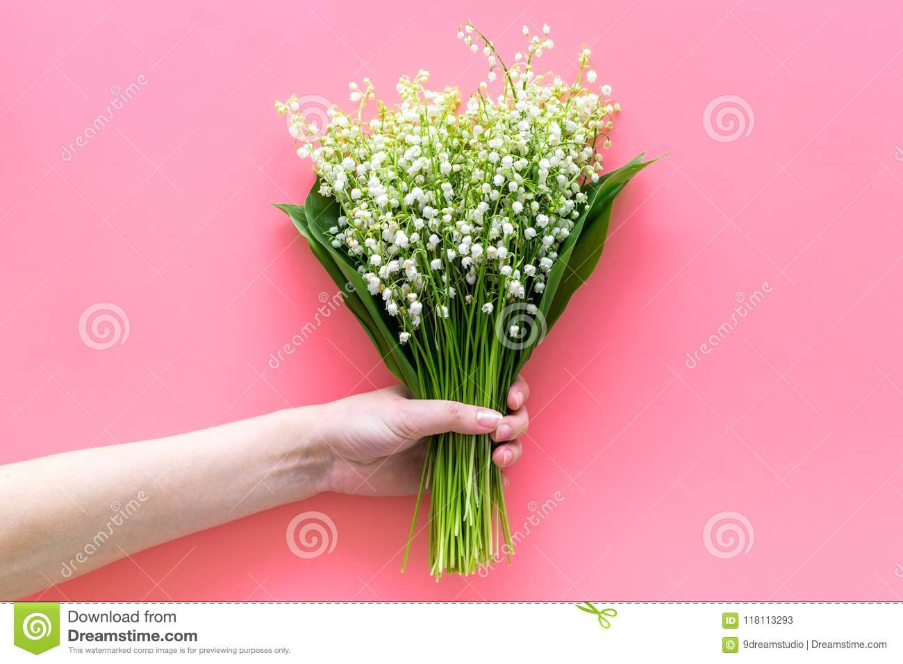 Give A Bouquet Of Delicate Lily Of The Valley Flowers. Hand Hold ...