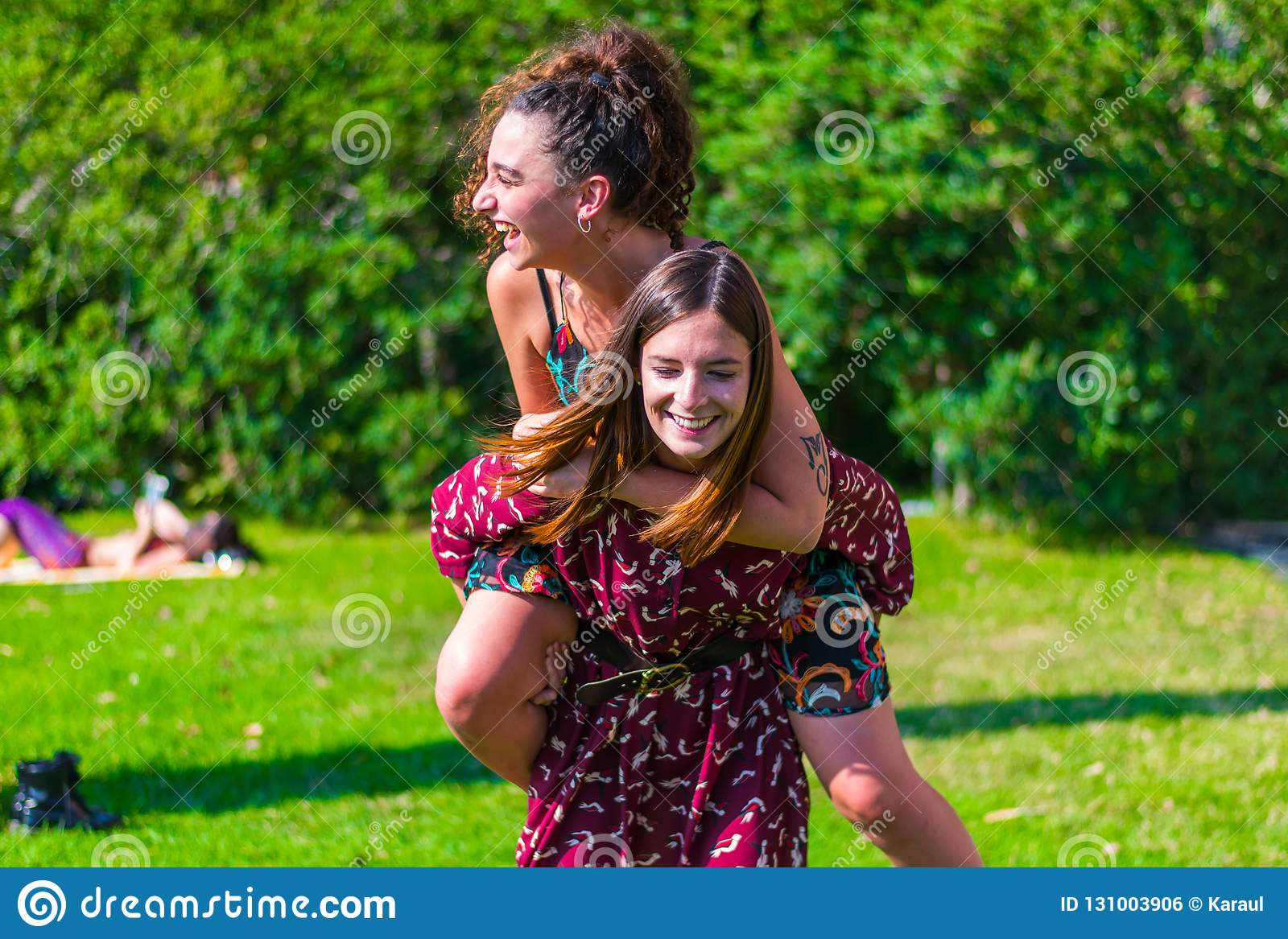 Give me a piggyback ride stock photo  Image of bestfriends