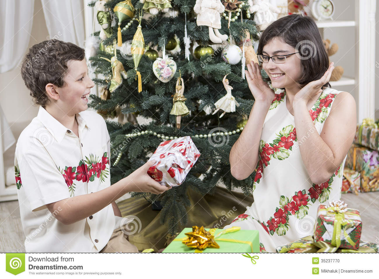 Giving Christmas gifts stock photo. Image of holds, ribbons - 35237770