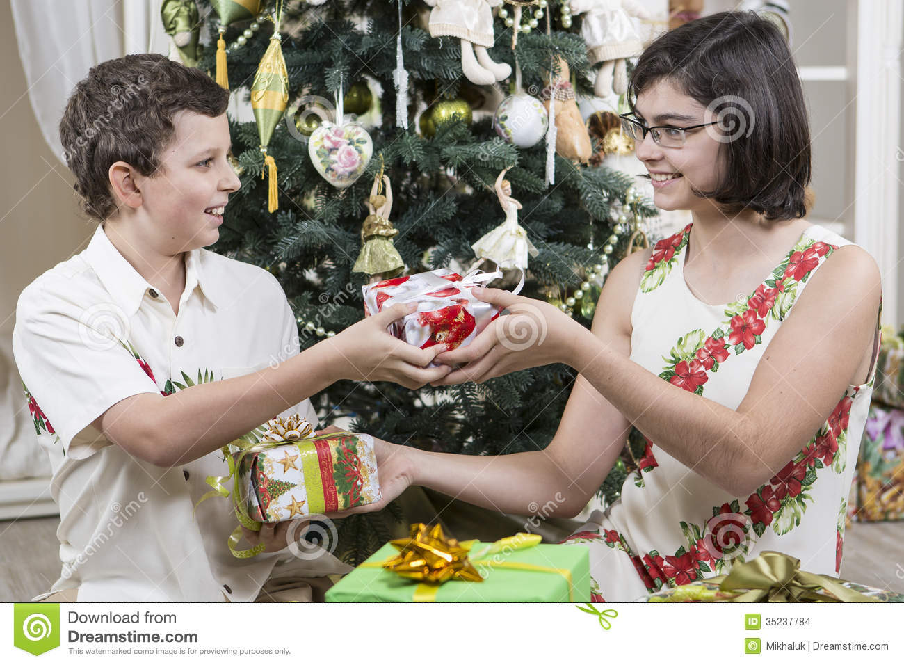Giving Christmas gifts stock photo. Image of accepts - 35237784