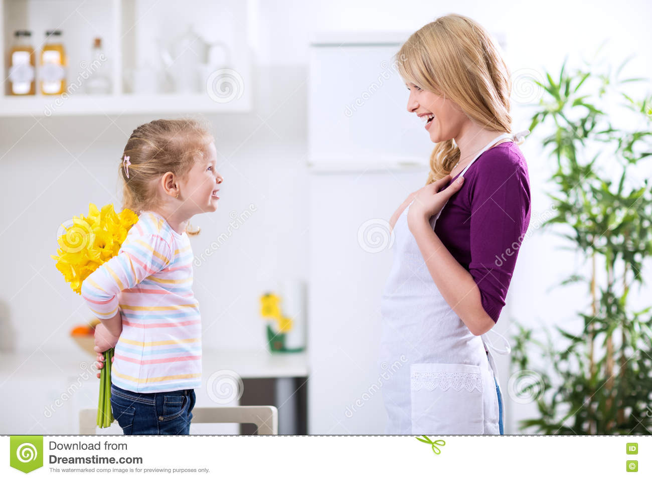 Giving Flowers To Beautiful Mother For Happy Birthday Stock Photo
