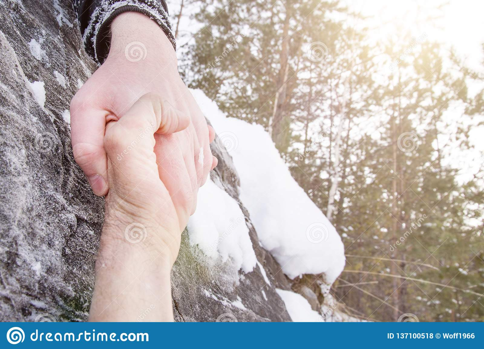 Giving a helping hand. Snow in the mountains