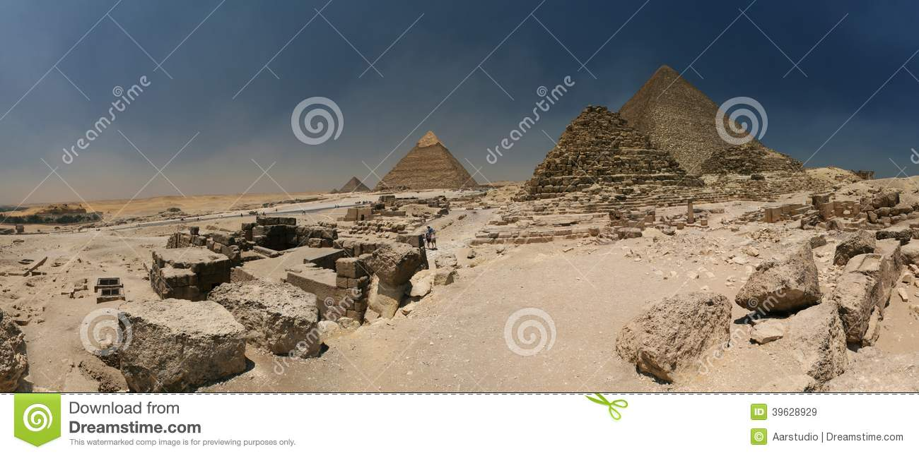 Giza plateau - with all three big pyramids (the darker one close to the centre is small pyramid for a queen) and a Sphinx on the