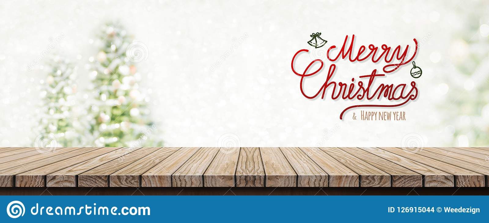 Glad jul för röd handskrift och lyckligt nytt år över den wood fliken