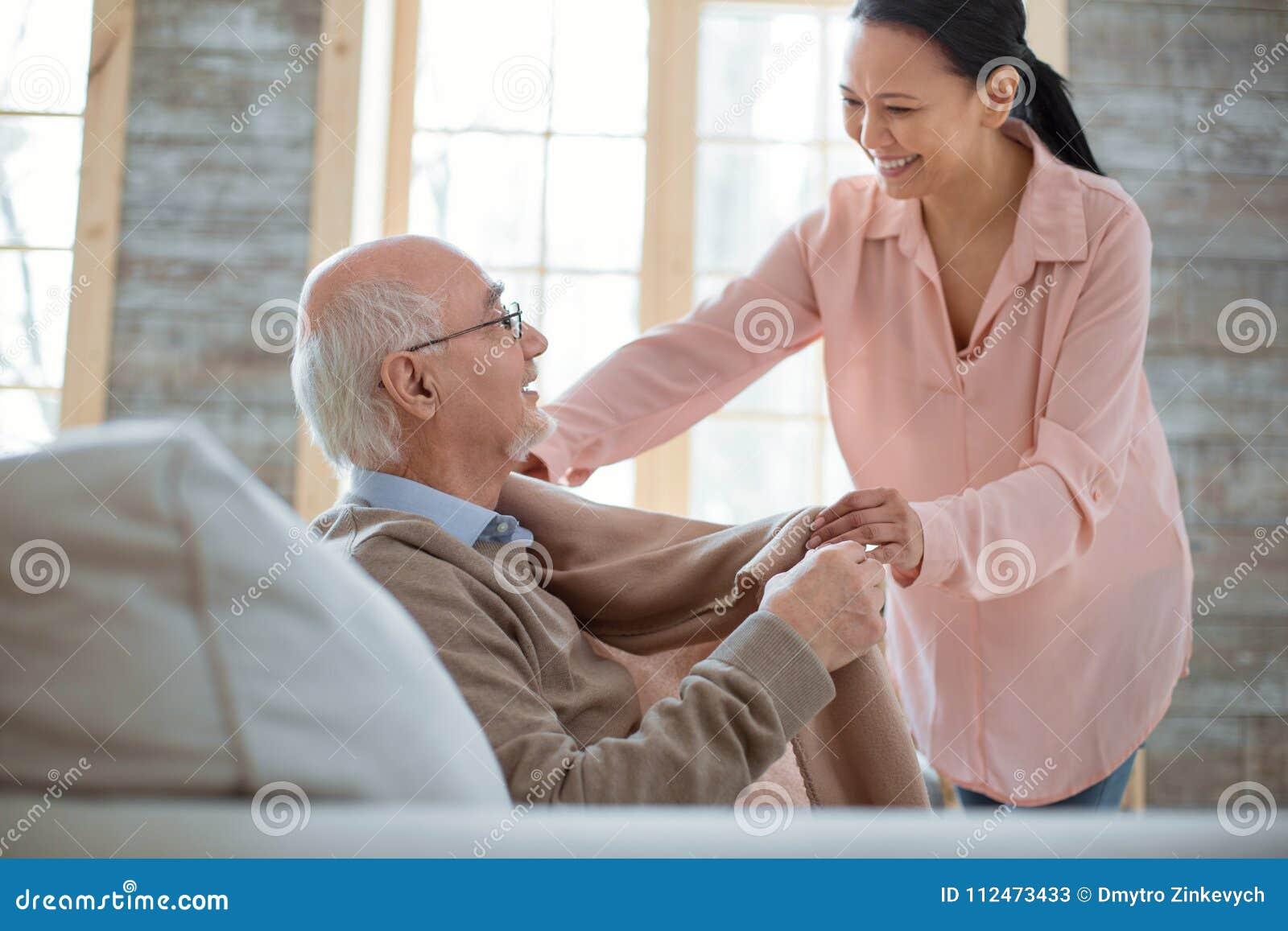Glad senior man asking for help caregiver