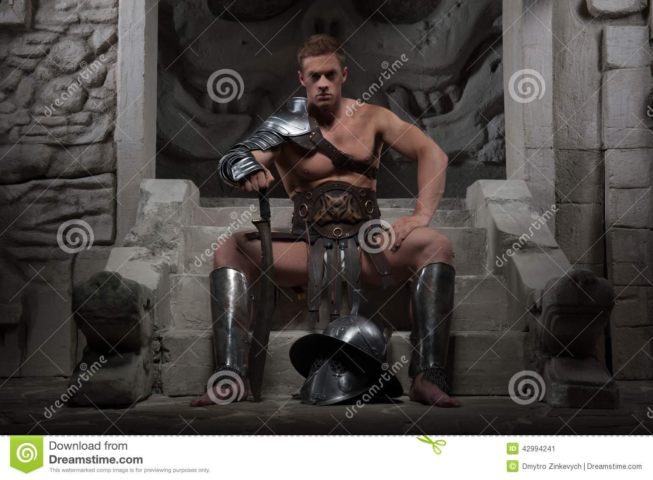 Gladiator in armour sitting on steps of ancient