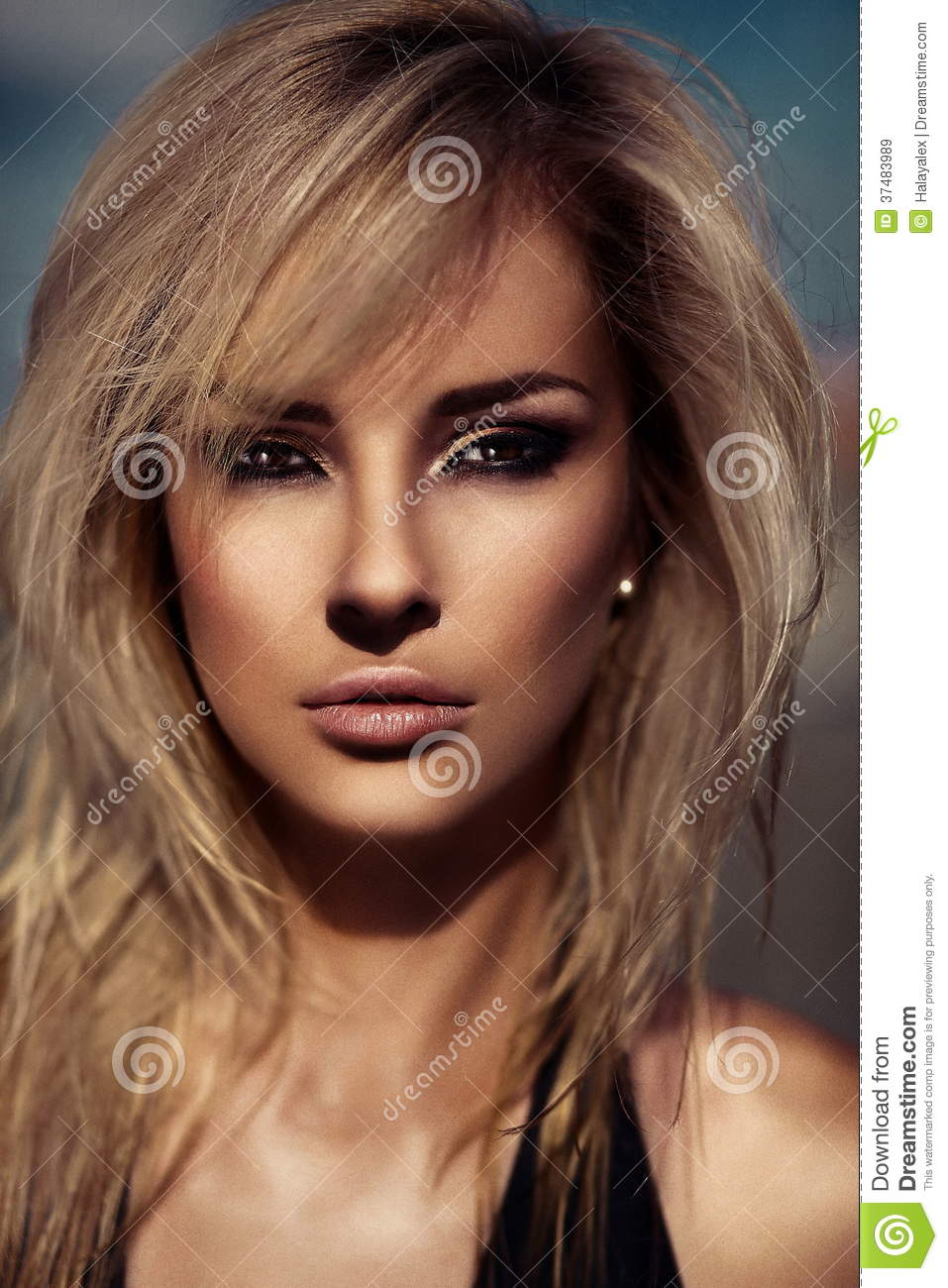 Glamor closeup portrait of beautiful stylish blond Caucasian young woman model with bright makeup, with perfect sunbathed