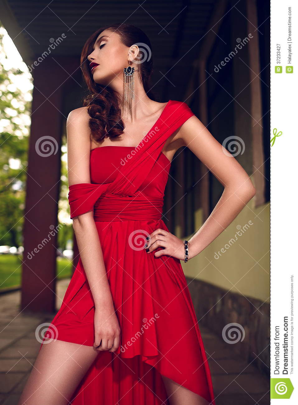Glamor closeup portrait of beautiful stylish brunette Caucasian young woman model with bright makeup, with red dark lips, in