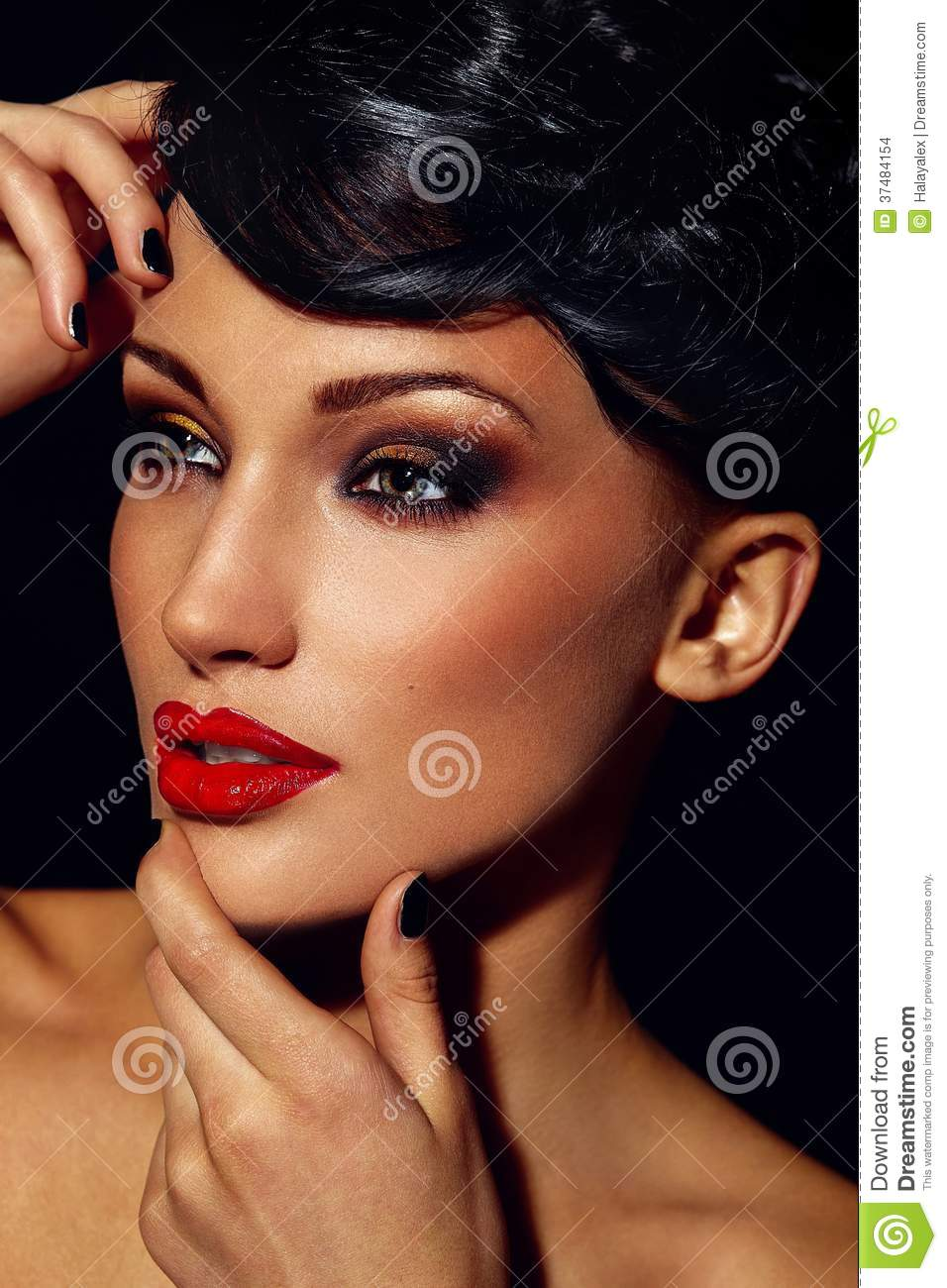 Glamor closeup portrait of beautiful stylish brunette Caucasian young woman model with bright makeup, with red lips, with per