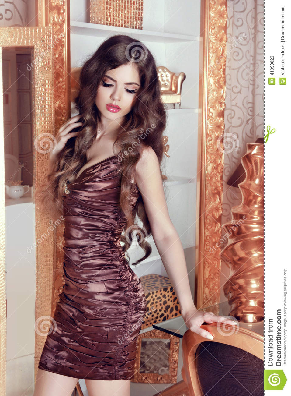 Glamorous beautiful girl model with long wavy hair female Ciaafrique fashion beauty style