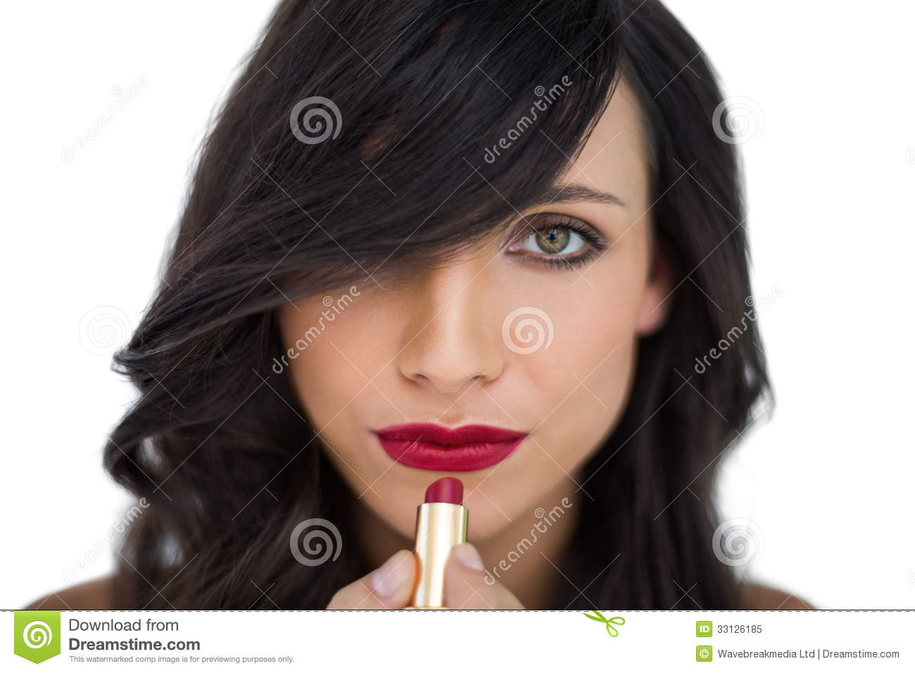 Glamorous Brunette Applying Red Lipstick Stock Image