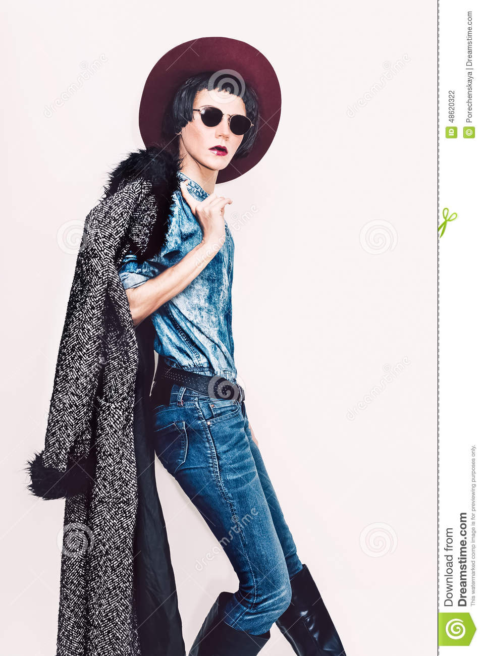 Glamorous Fashion Model In Coat And Stylish Jeans Clothes