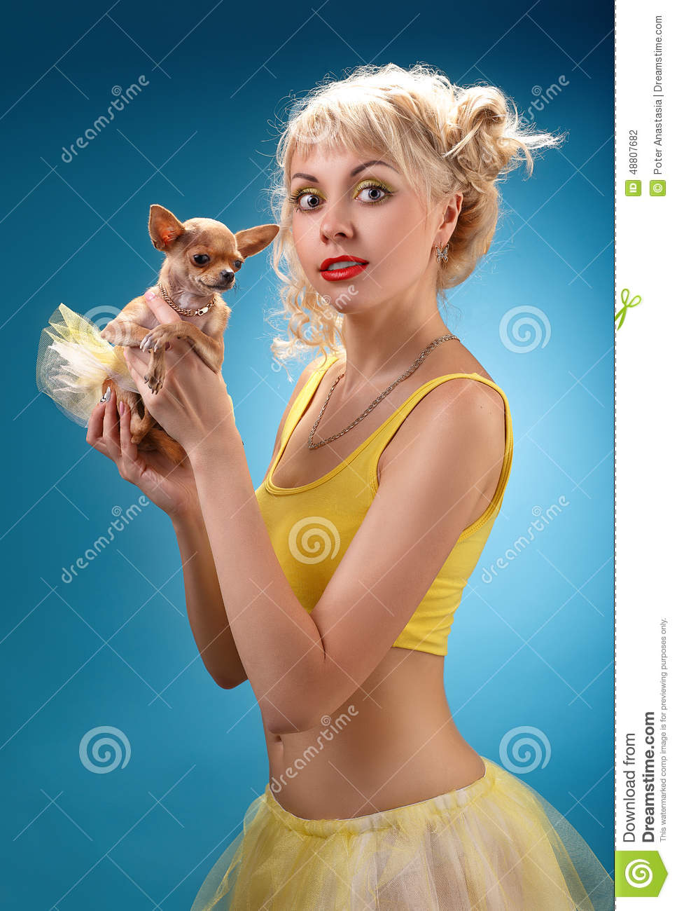 Glamorous Girl Holding A Chihuahua Dog Blonde Hugging A