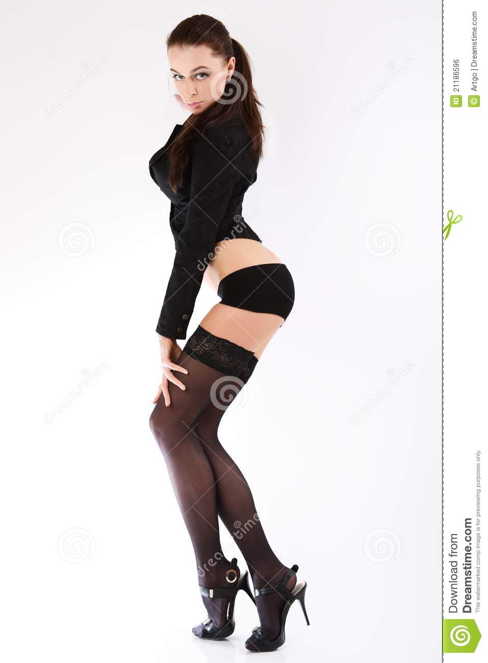 Glamorous woman in black stockings and jacket.