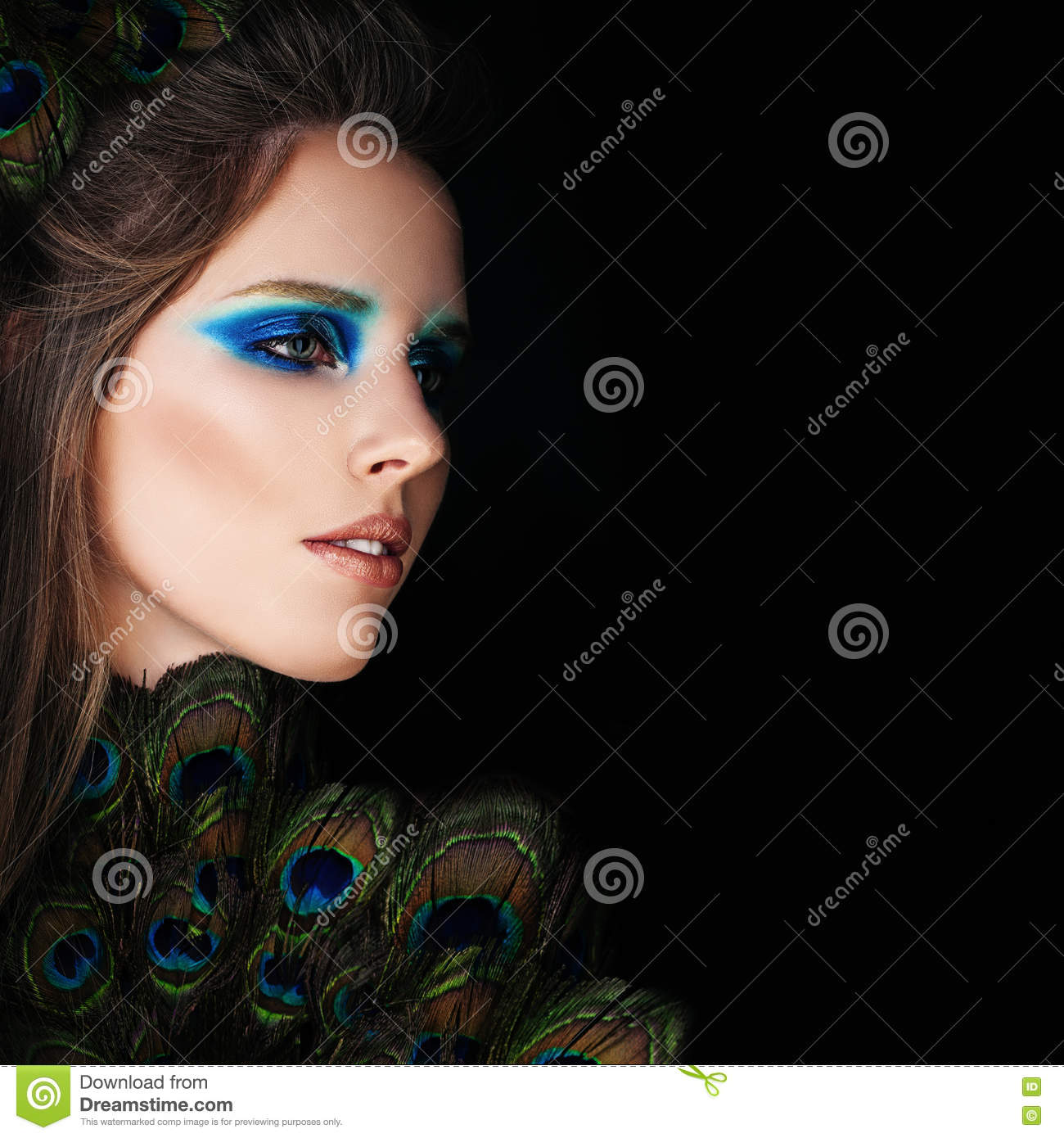 Glamorous Woman with Makeup and Peacock Feathers on Black
