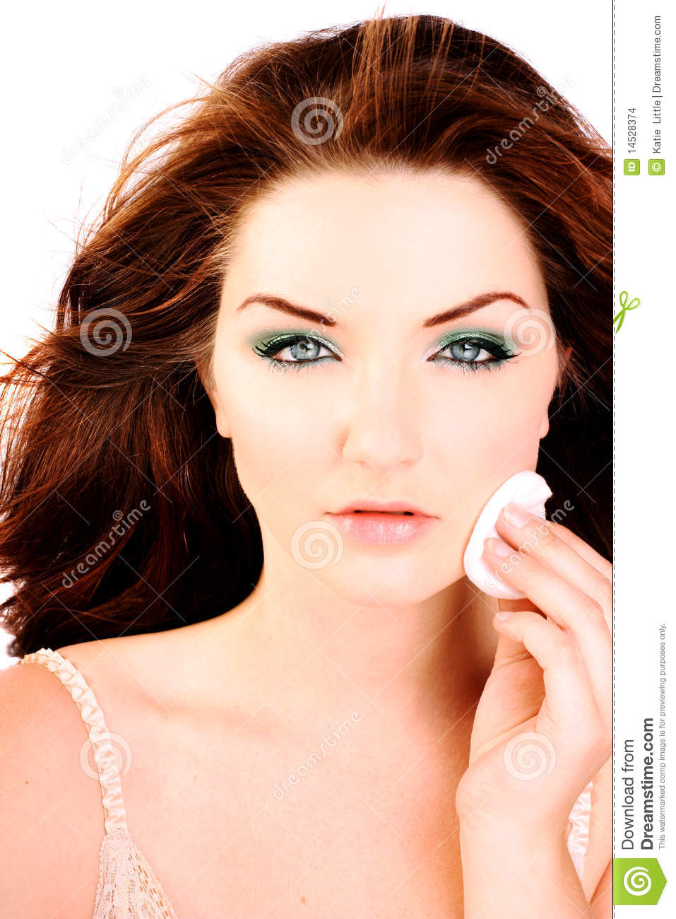 Glamorous woman removing her make up