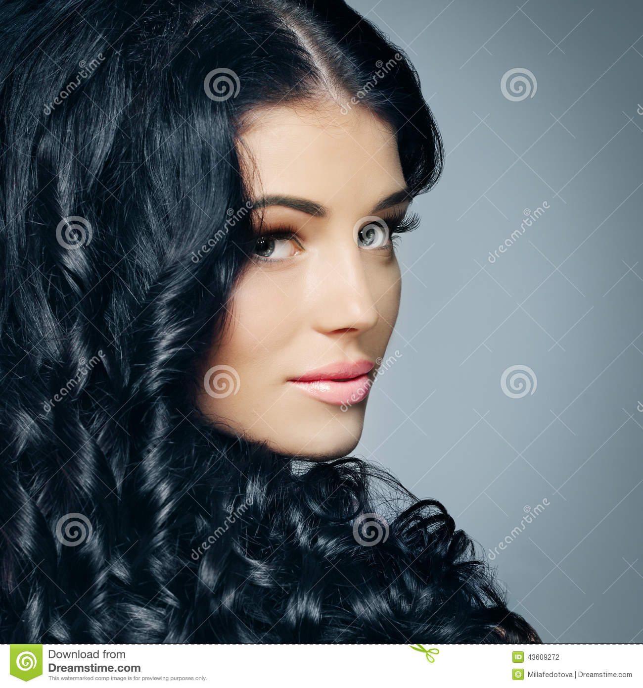 Glamour brunette with beautiful hair and makeup