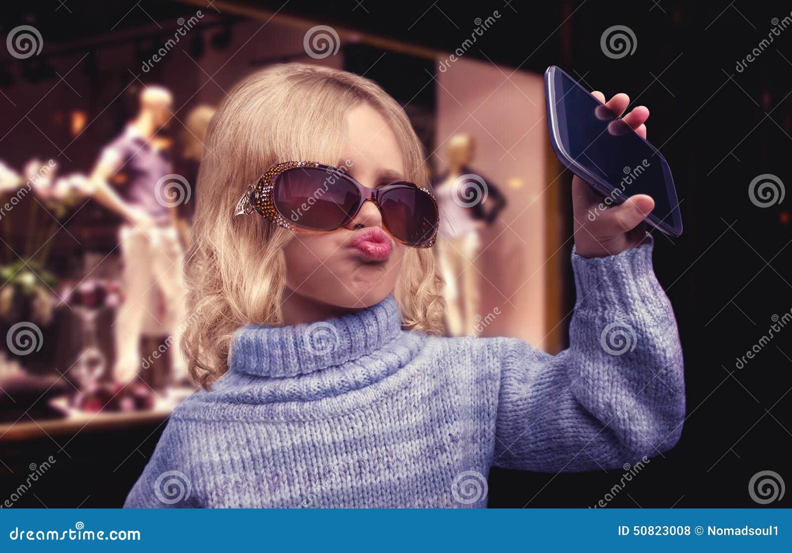 Glamour little girl talks on phone
