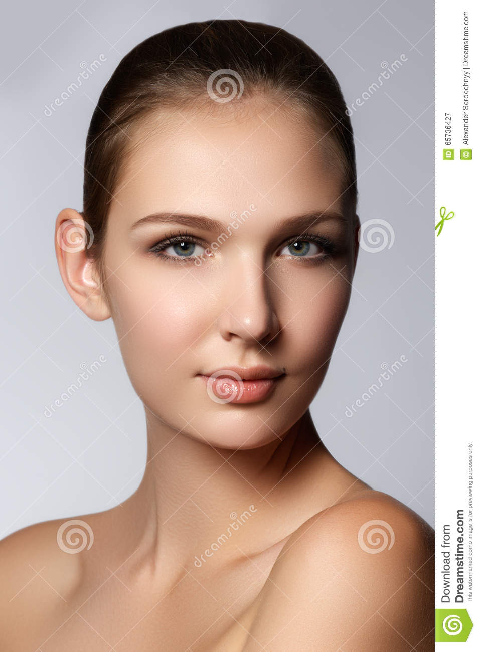 Glamour portrait of beautiful woman model with fresh daily makeup. Fashion shiny highlighter on skin, gloss lips make-up and