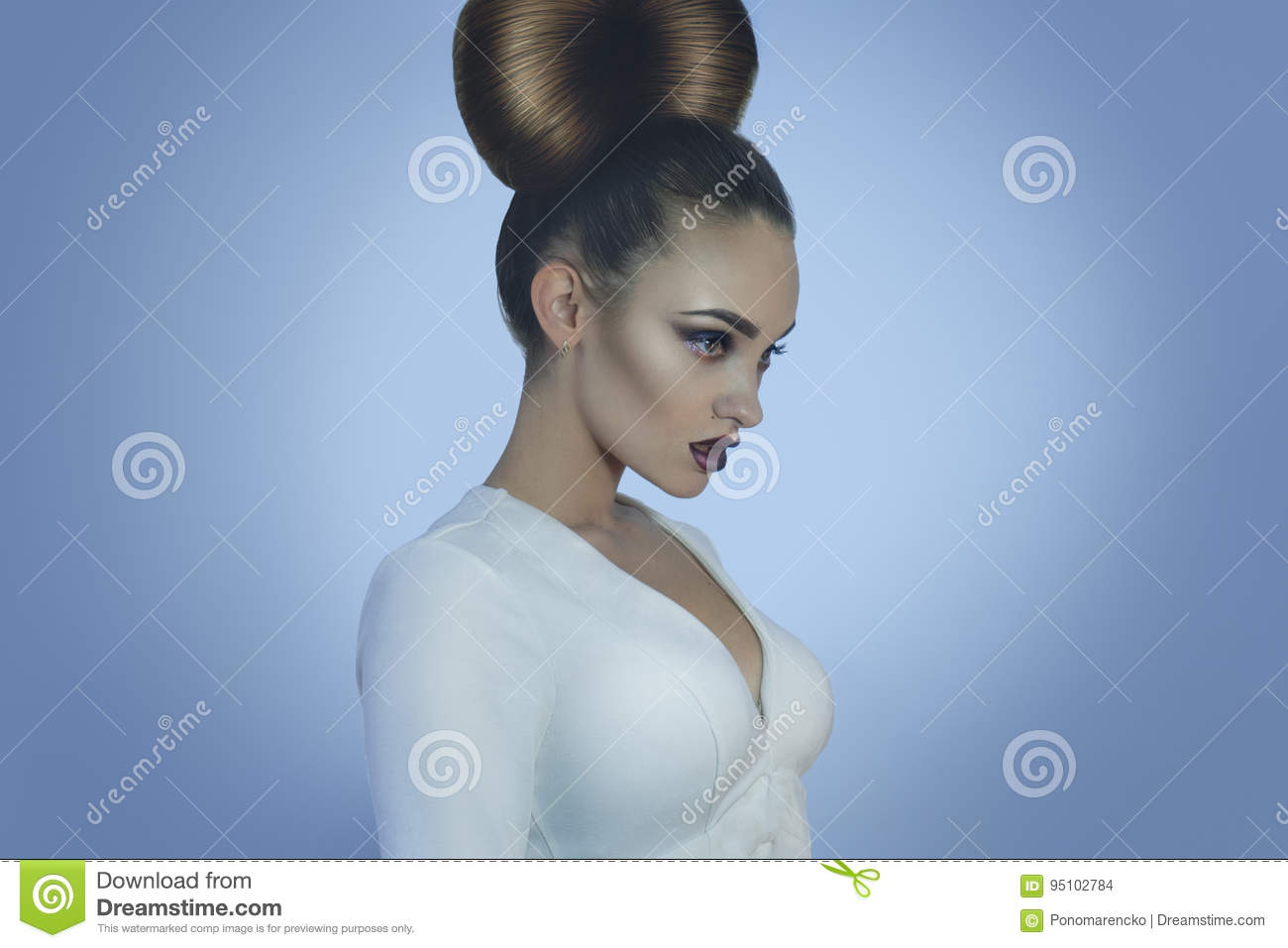 Glamour young lady with creative hairstyle and make up