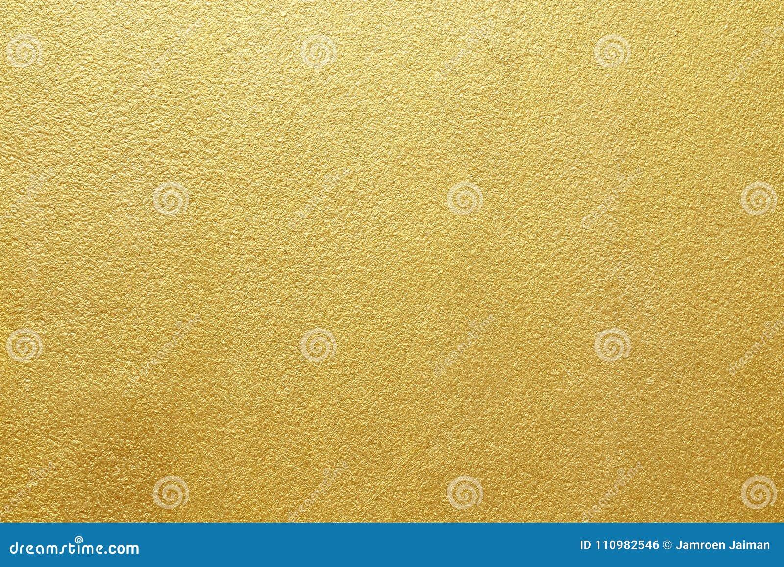 Glanzend geel bladgoud van de achtergrond van de muurtextuur