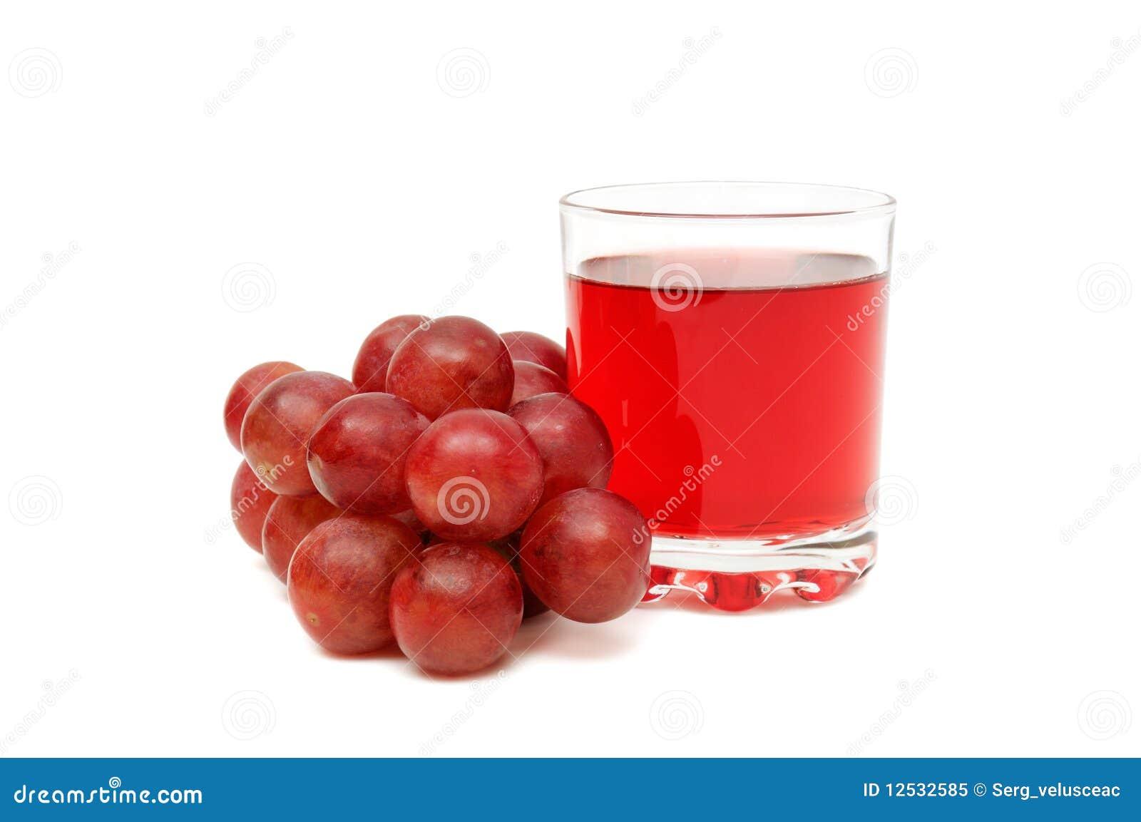Glas mit Saft und Trauben