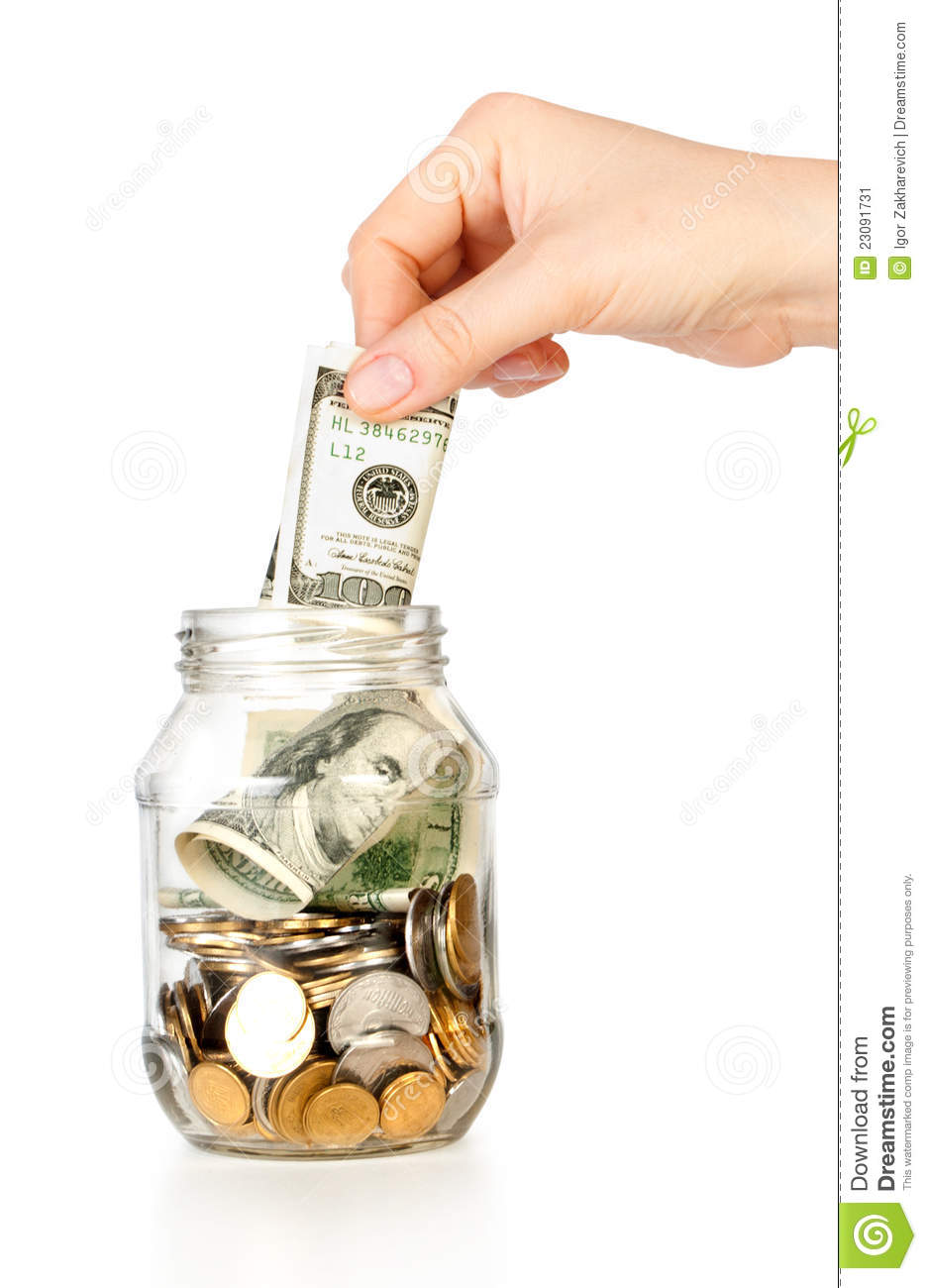 Glass Bank For Tips With Money And Hand Put Dollar Stock