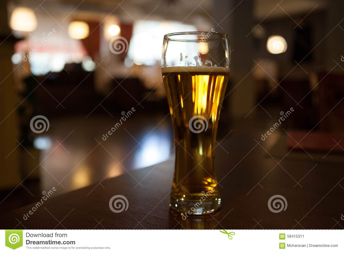 A glass of beer on the corner table in the restaurant