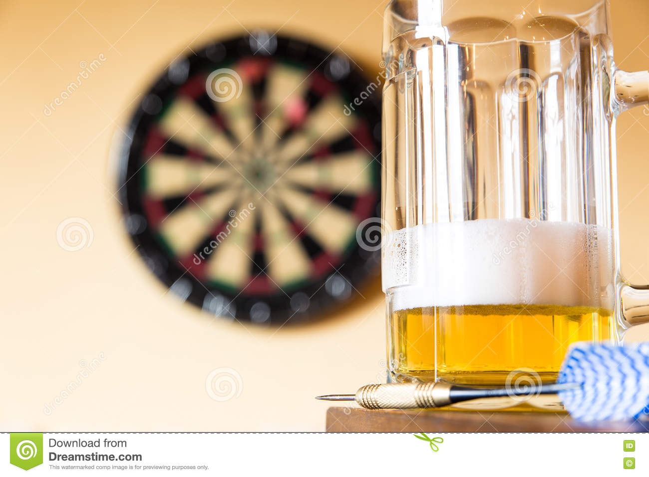 Glass of beer and dartboard
