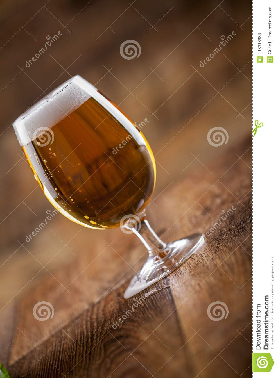 A glass with beer and foam