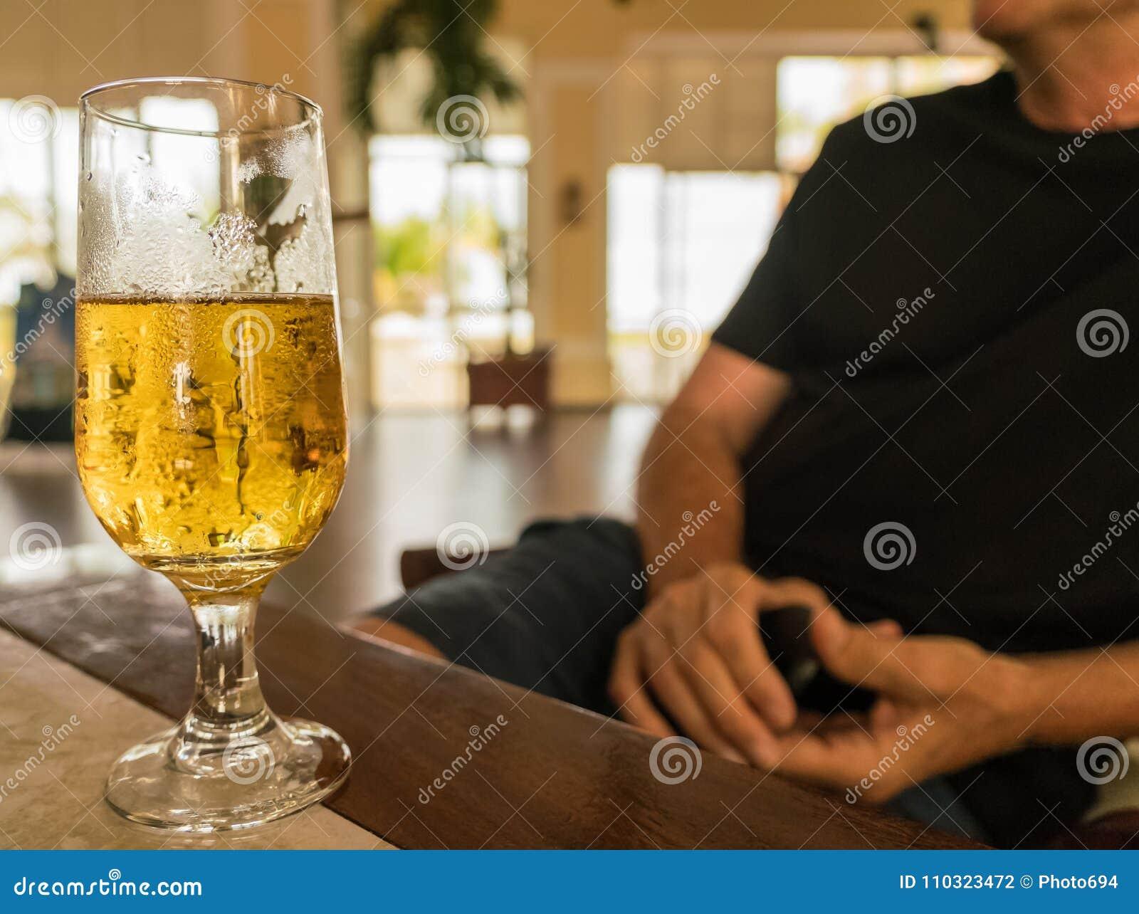 Glass of beer - unfocused man