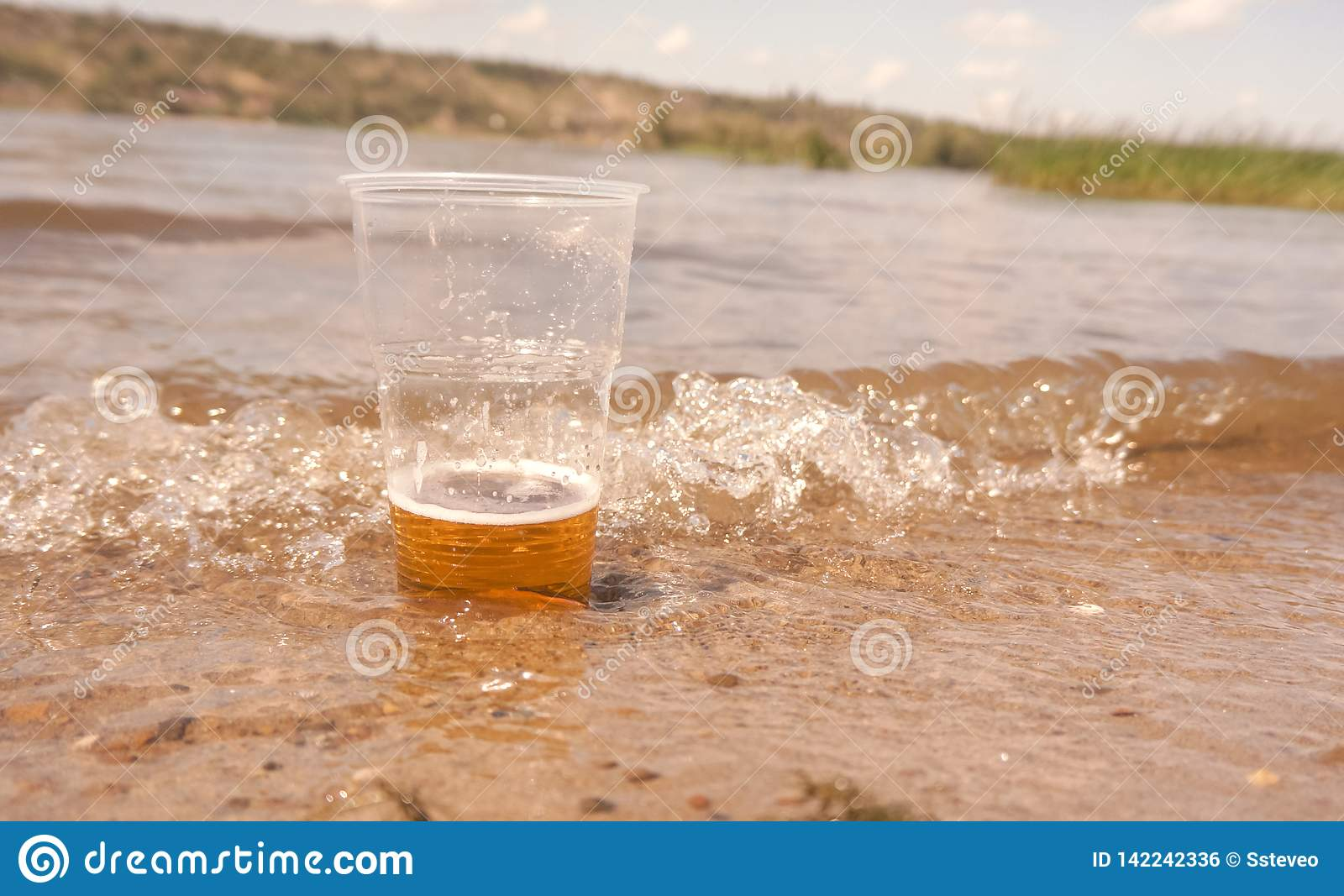 A glass of beer in the water