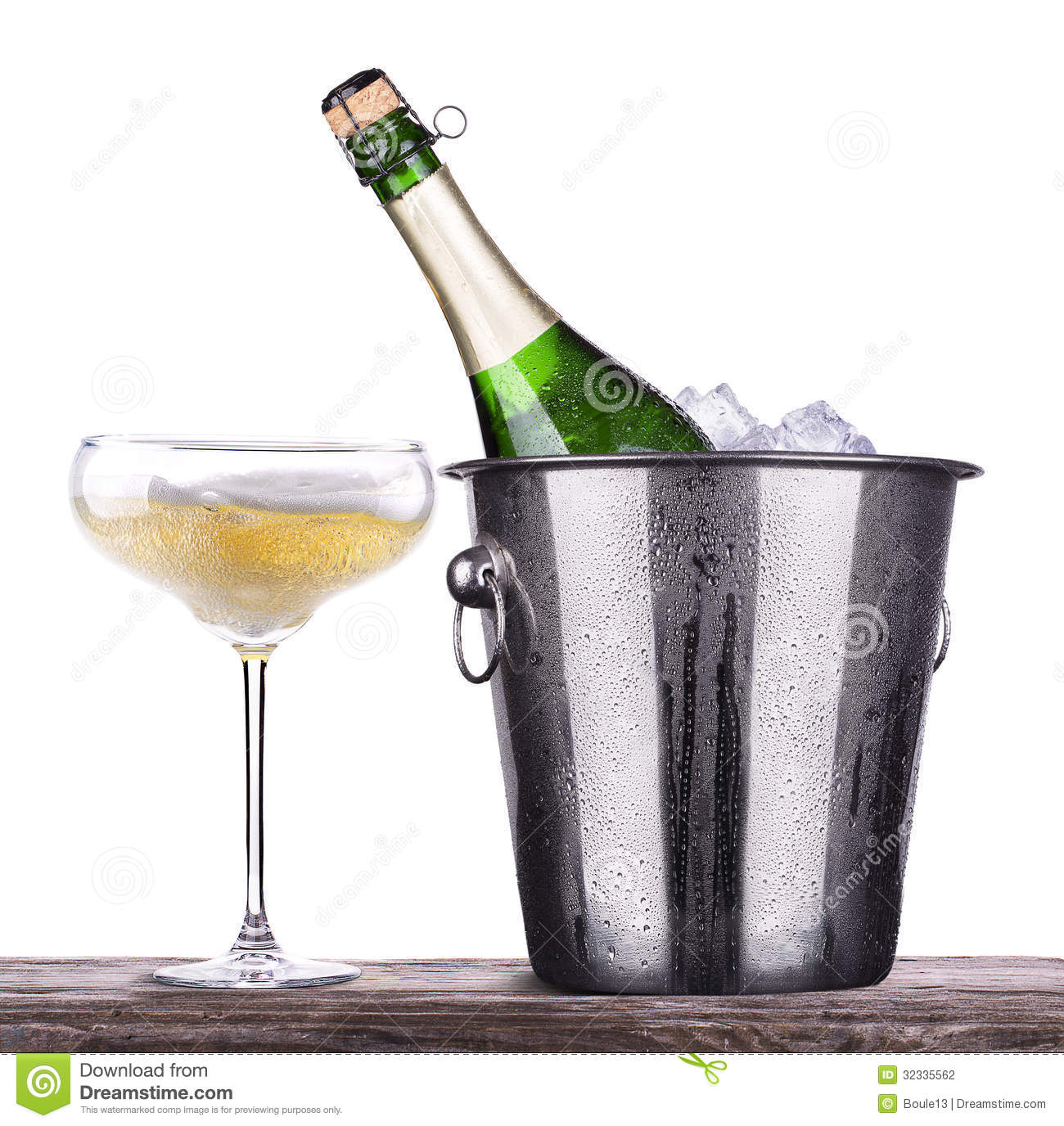 Glass And Bottle Of Champagne In Ice Bucket Stock Photo Image