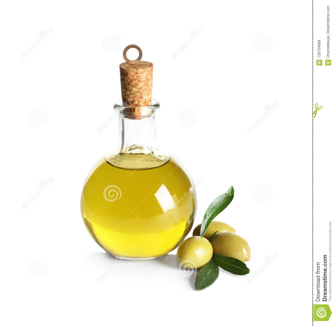 Glass bottle with fresh olive oil