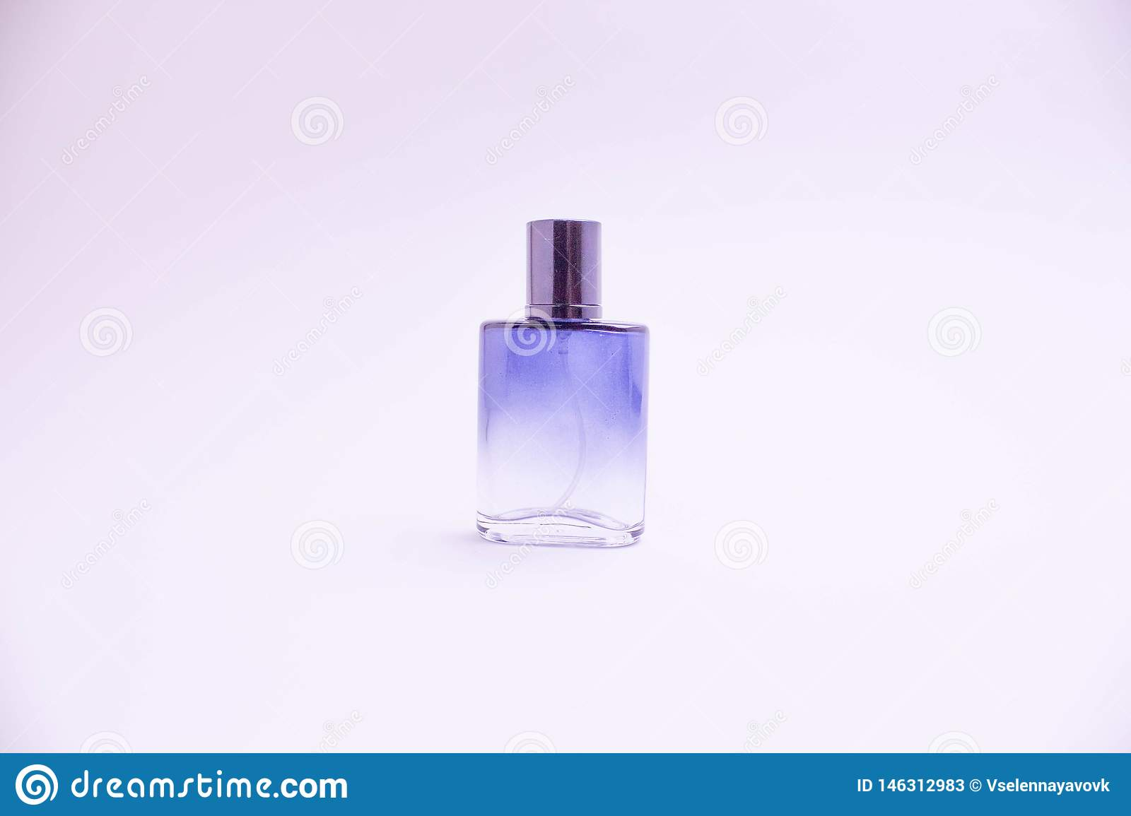 Glass bottle of perfume on white background. Pink, blue, green, black bottle. Women`s and men`s perfume. Aromatherapy, spa.