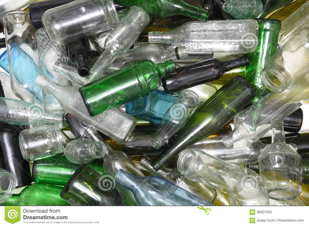 Glass bottles inside a glass recycling