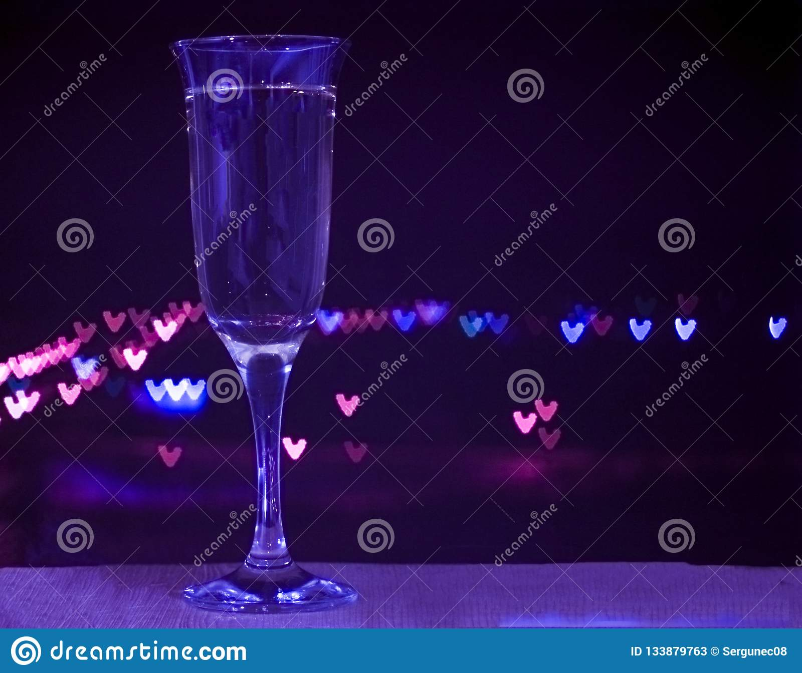 Glass of champagne on bokeh background