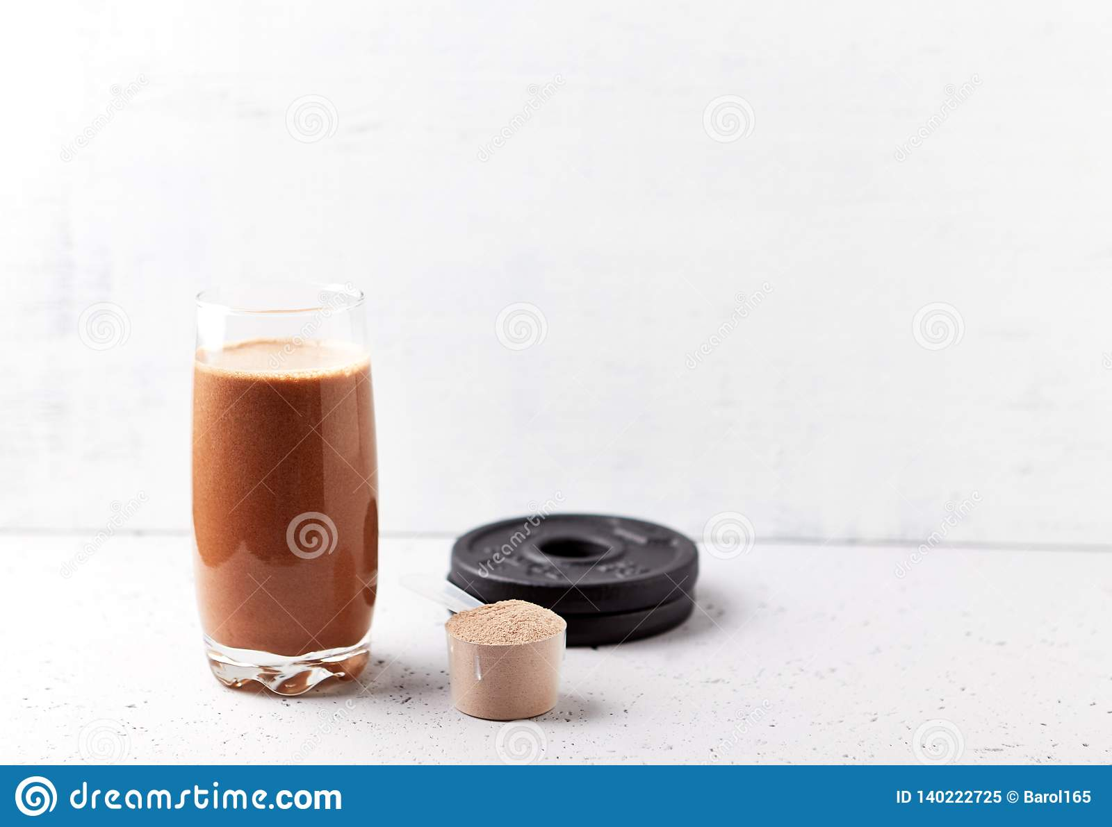 Glass Of Chocolate Protein Shake With Milk And Banana Whey Protein In Scoop And Black Plates In Background Sport Nutrition Stock Image Image Of Meal Bright 140222725