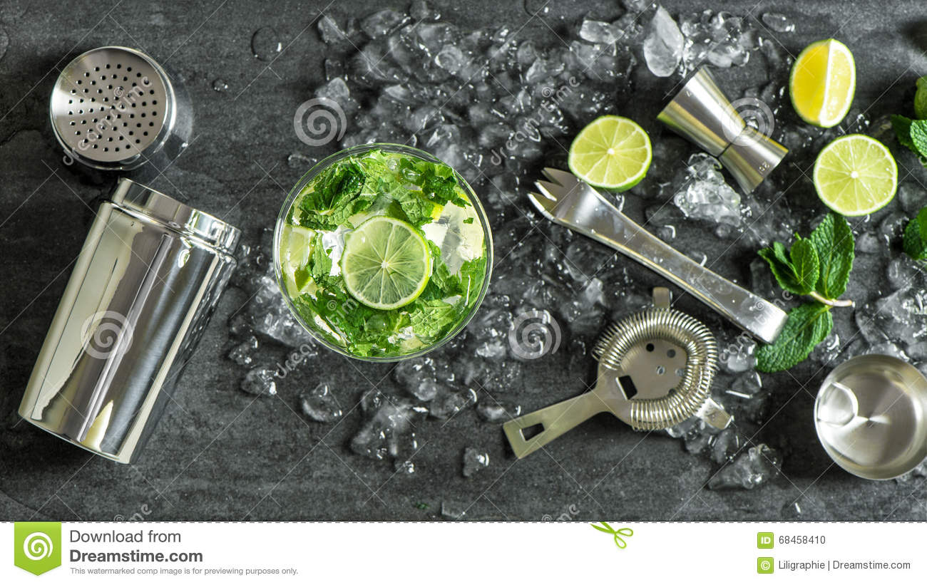 Glass cocktail lime, mint, ice. Drink making bar tools shaker