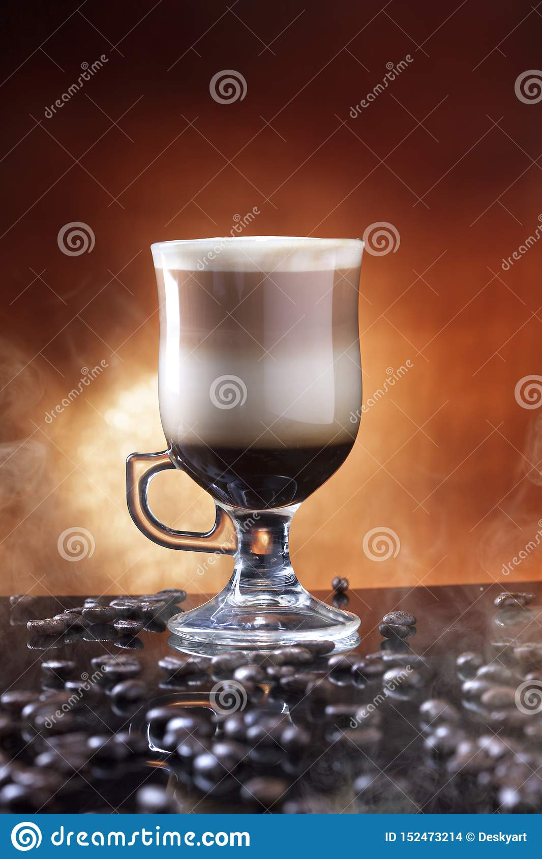 A Glass Of Coffee Latte On A Table Sprinkled With Coffee ...