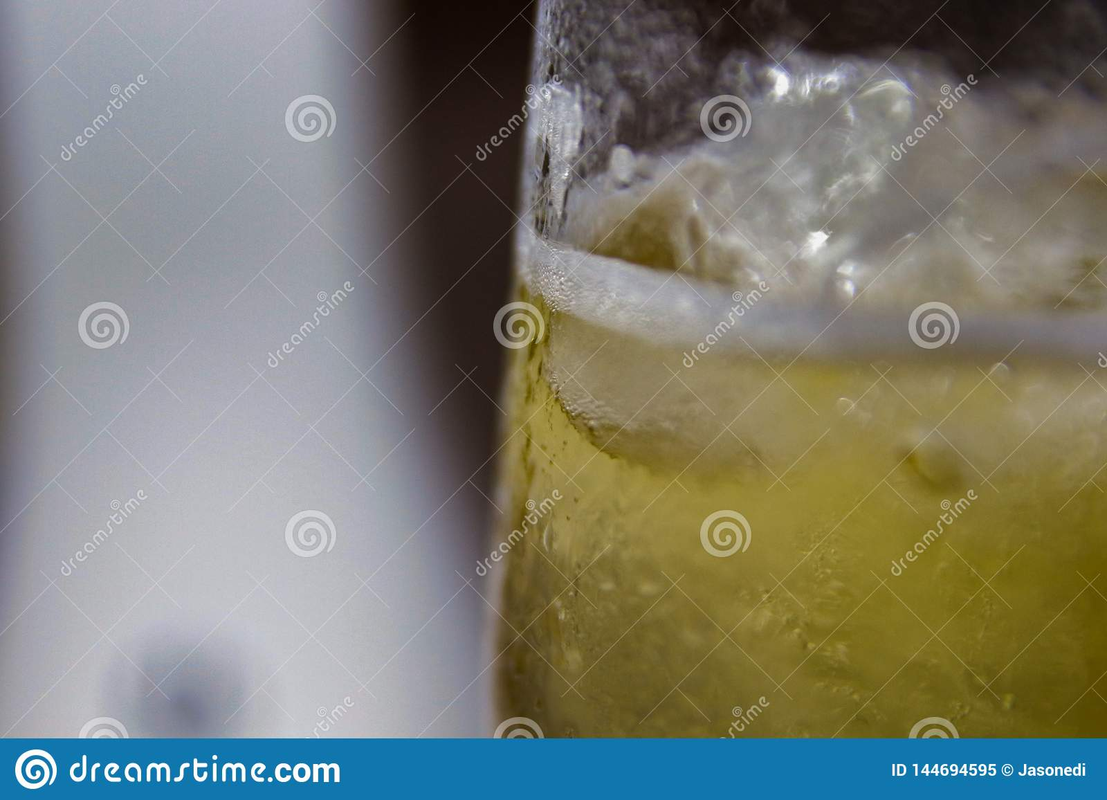 Glass of cold beer with condensed water