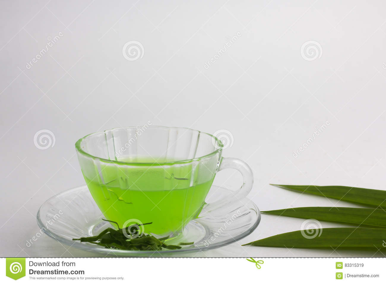 Glass of cold Pandan juice - healthy food against wood,With pan
